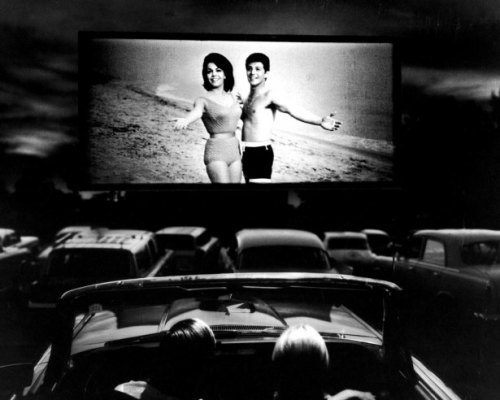 01 Annette Funicello and Frankie Avalon in a scene from Beach Blanket Bingo, shown at a drive-in movie theater in Florida, 1965
